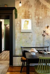 Ein Restaurant oder anderes Speiselokal in der Unterkunft Le Boutik Hotel