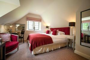 A bed or beds in a room at The Slaughters Country Inn