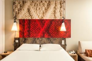 Кровать или кровати в номере Ибис Москва Киевская