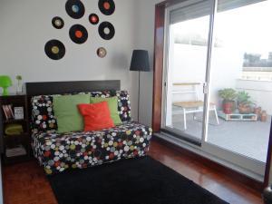 Uma área de estar em Alegria Apartment Porto Downtown