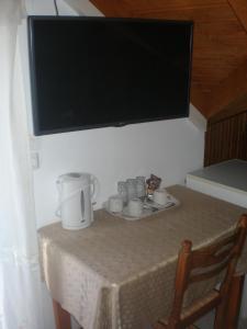 TV o dispositivi per l'intrattenimento presso Nicolas Rooms