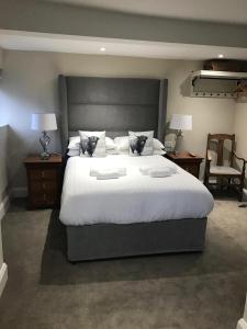 A bed or beds in a room at The Bulls Head