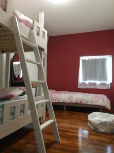 A bunk bed or bunk beds in a room at Guest House Unity