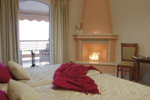 Ένα ή περισσότερα κρεβάτια σε δωμάτιο στο Over Sea Rooms & Villas