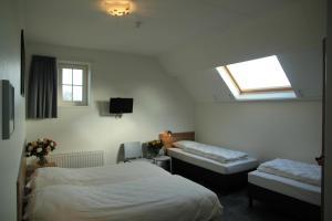 Een bed of bedden in een kamer bij Duinoord Oostkapelle