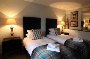 A bed or beds in a room at The King's Head