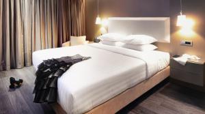 מיטה או מיטות בחדר ב-Saz City Life Hotel