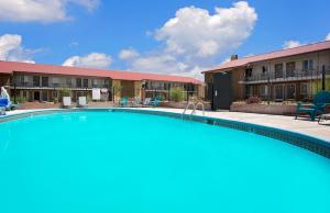 The swimming pool at or close to Super 8 by Wyndham Denver Central