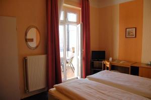 Кровать или кровати в номере Hotel Graf Pückler