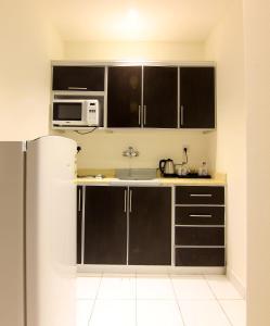 A cozinha ou cozinha compacta de Aliah Tolan Palace