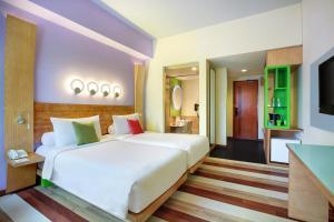 Ein Bett oder Betten in einem Zimmer der Unterkunft ibis Styles Yogyakarta