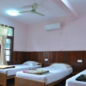 Ein Bett oder Betten in einem Zimmer der Unterkunft Shwe Nadi Guest House