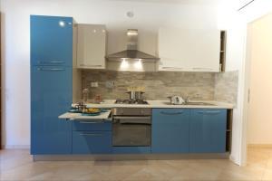 Кухня или мини-кухня в Piper Residence