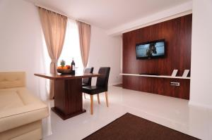 A television and/or entertainment centre at Apartment Arsenal 1