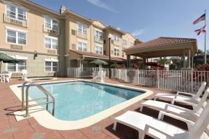 The swimming pool at or near Country Inn & Suites by Radisson, St. Augustine Downtown Historic District, FL