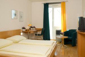 Ein Bett oder Betten in einem Zimmer der Unterkunft Hotel GIP