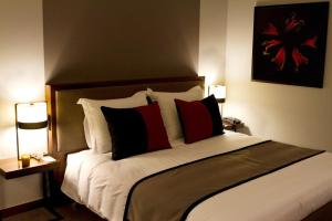 A bed or beds in a room at Hotel Dighton