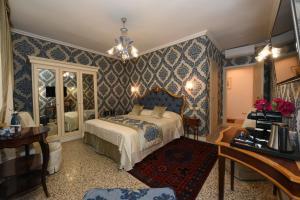 Кровать или кровати в номере 40.17 SAN MARCO