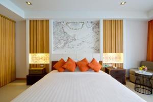 Кровать или кровати в номере Welcome World Beach Resort & Spa