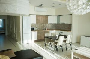 Кухня или мини-кухня в Апарт-отель ApartSochi