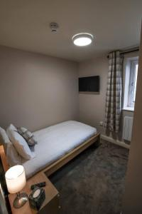 A bed or beds in a room at Morecambe Rooms