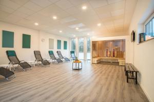 Das Fitnesscenter und/oder die Fitnesseinrichtungen in der Unterkunft Sporthotel Grünberg