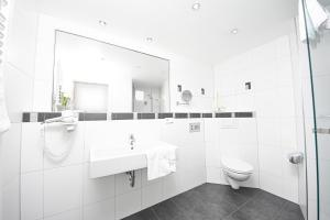 Ванная комната в Hotel Zum grünen Kranz