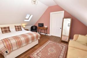 A bed or beds in a room at Cardhu Country House