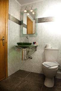 A bathroom at Filoxenia Hotel