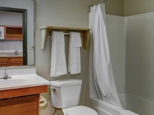 A bathroom at WoodSpring Suites Topeka