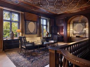 A seating area at Schlosshotel Berlin by Patrick Hellmann