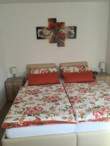 A bed or beds in a room at Pension Ulrich