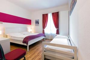 Ein Bett oder Betten in einem Zimmer der Unterkunft Hotel Croce Federale