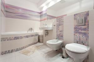 Łazienka w obiekcie Apartamenty Olimpic