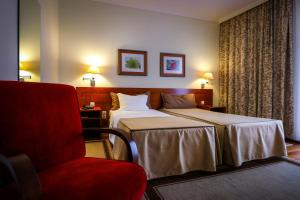 A bed or beds in a room at Hotel Camoes