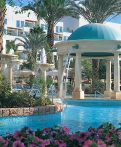 The swimming pool at or near Isrotel Royal Garden All-Suites Hotel