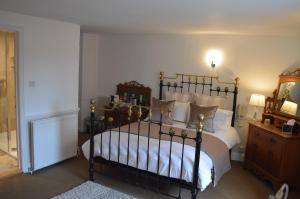 A bed or beds in a room at Chantry Hotel