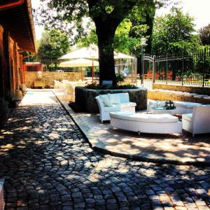 A garden outside Villa Del Cardinale