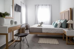 Un ou plusieurs lits dans un hébergement de l'établissement Impressive One