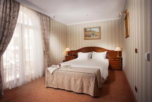 A bed or beds in a room at Hotel Otrada