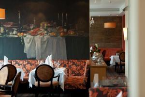 Ein Restaurant oder anderes Speiselokal in der Unterkunft Ringhotel Waldschlößchen