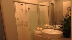 Um banheiro em Pousada Casa das Flores