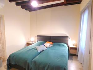 A bed or beds in a room at Ca' Neldo