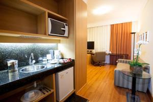A cozinha ou cozinha compacta de Quality Belo Horizonte Lourdes