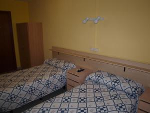 A bed or beds in a room at Hostal San Jorge
