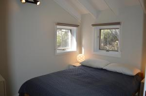 A bed or beds in a room at Byadbo 10