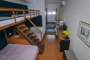 A bunk bed or bunk beds in a room at Amaris Bed & Breakfast - Quarantine Hotel