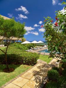 A garden outside Bon Azur Beachfront Suites & Penthouses by LOV