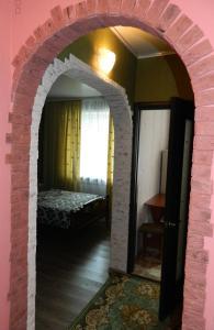 Кровать или кровати в номере Никитинская