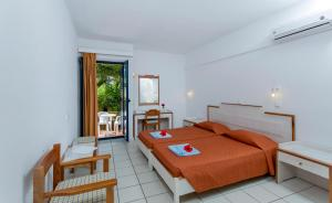 A bed or beds in a room at Dessole Dolphin Bay - All Inclusive